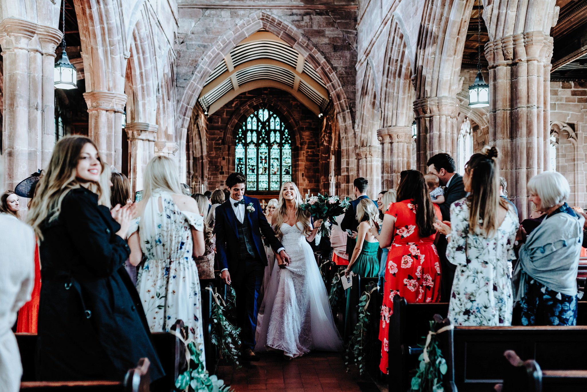 Bride and Groom walking down the aisle at Great Budworth church in Cheshire