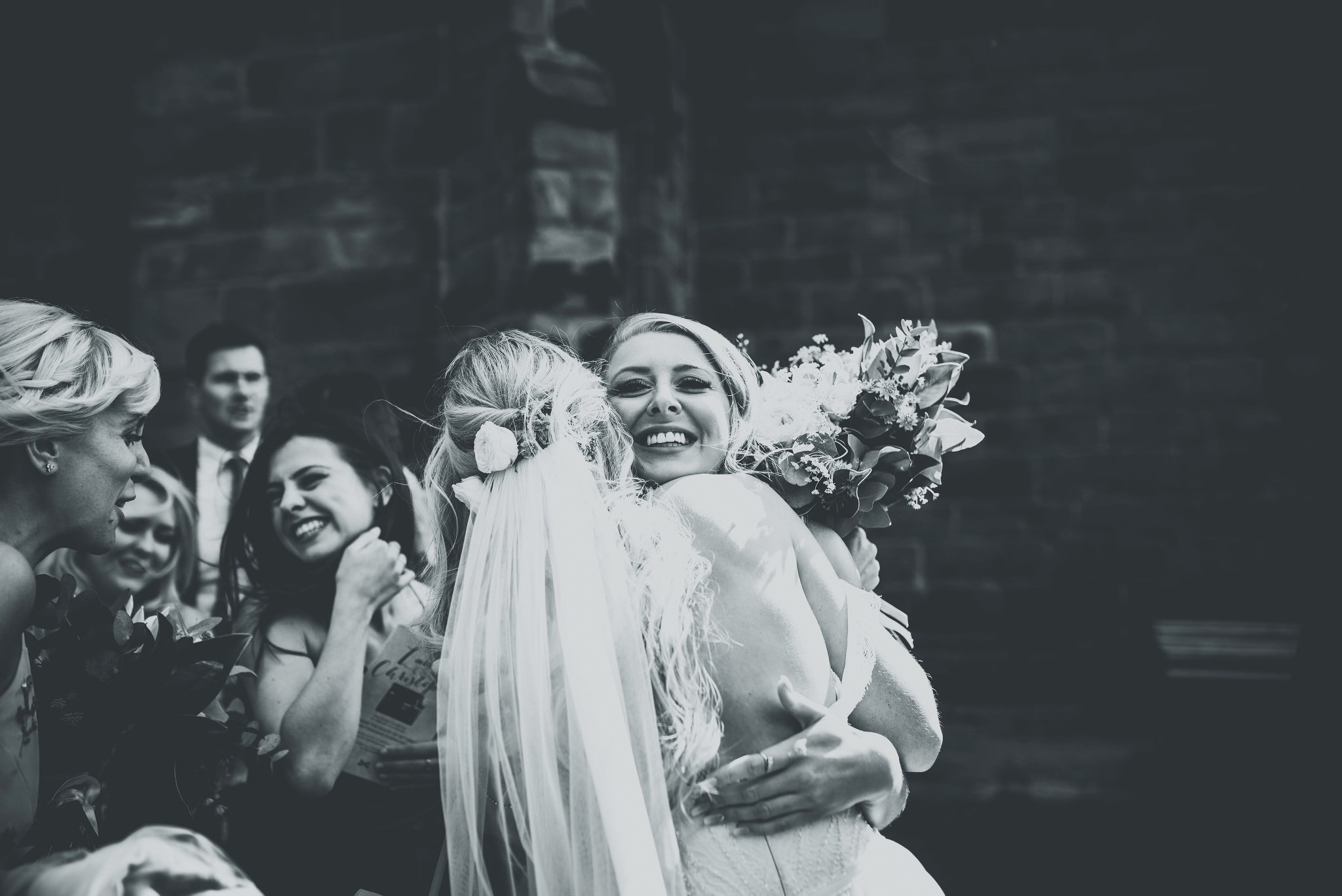 Bride hugging a guest at Cheshire Barn Wedding