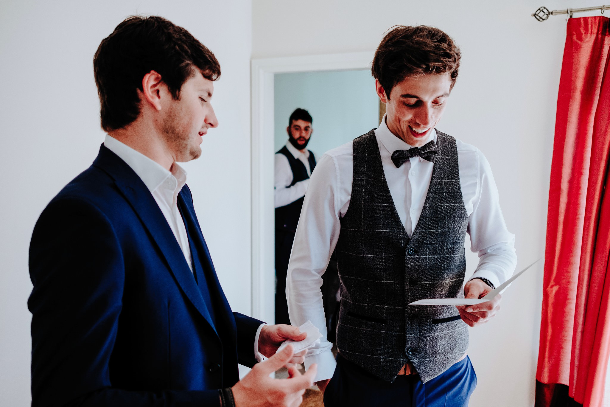Groom reading card on morning of his Cheshire Barn Wedding