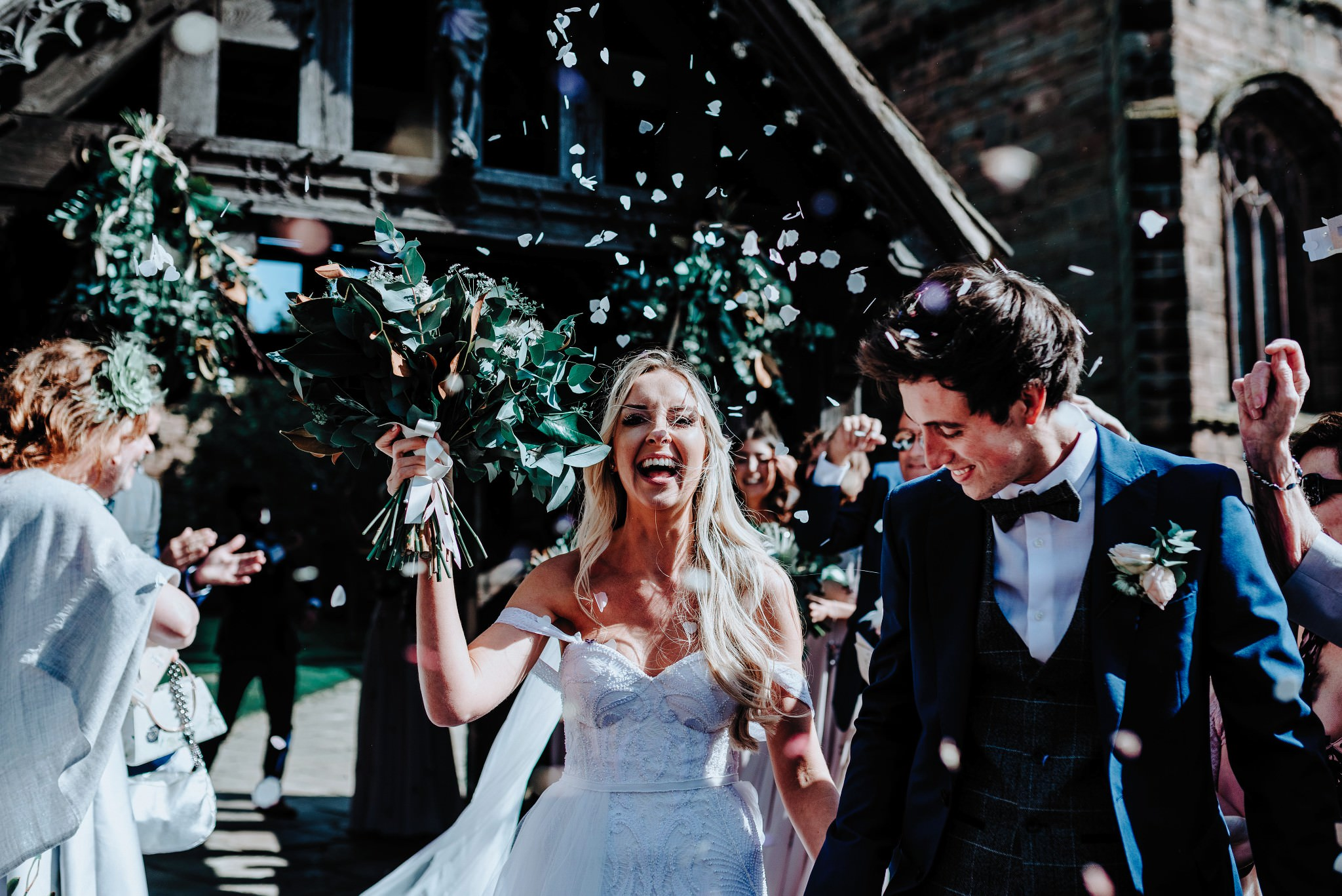 Bride and Groom and confetti at a Cheshire Barn Wedding