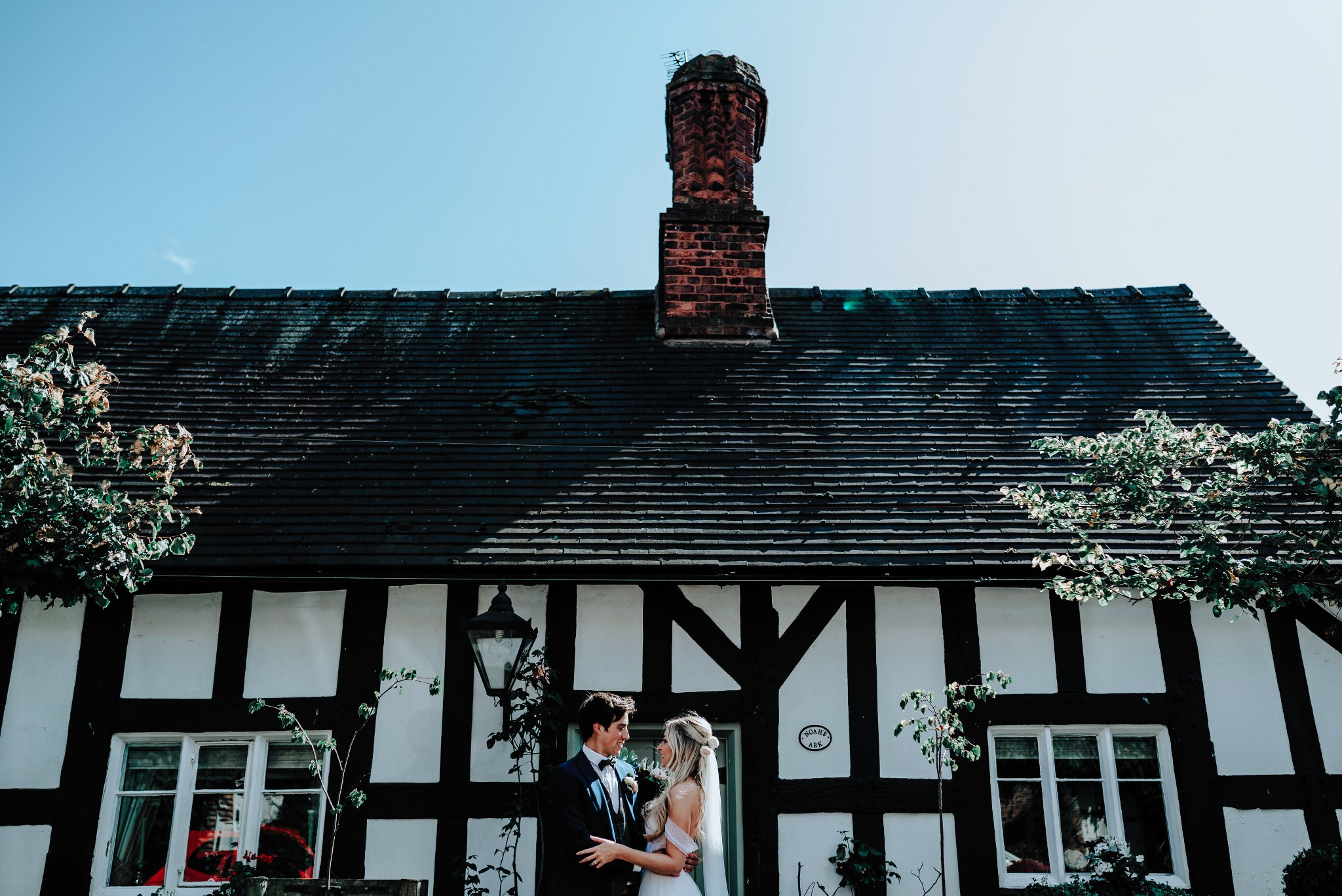 Bride and Groom outside cottage in Great Budworth in Cheshire