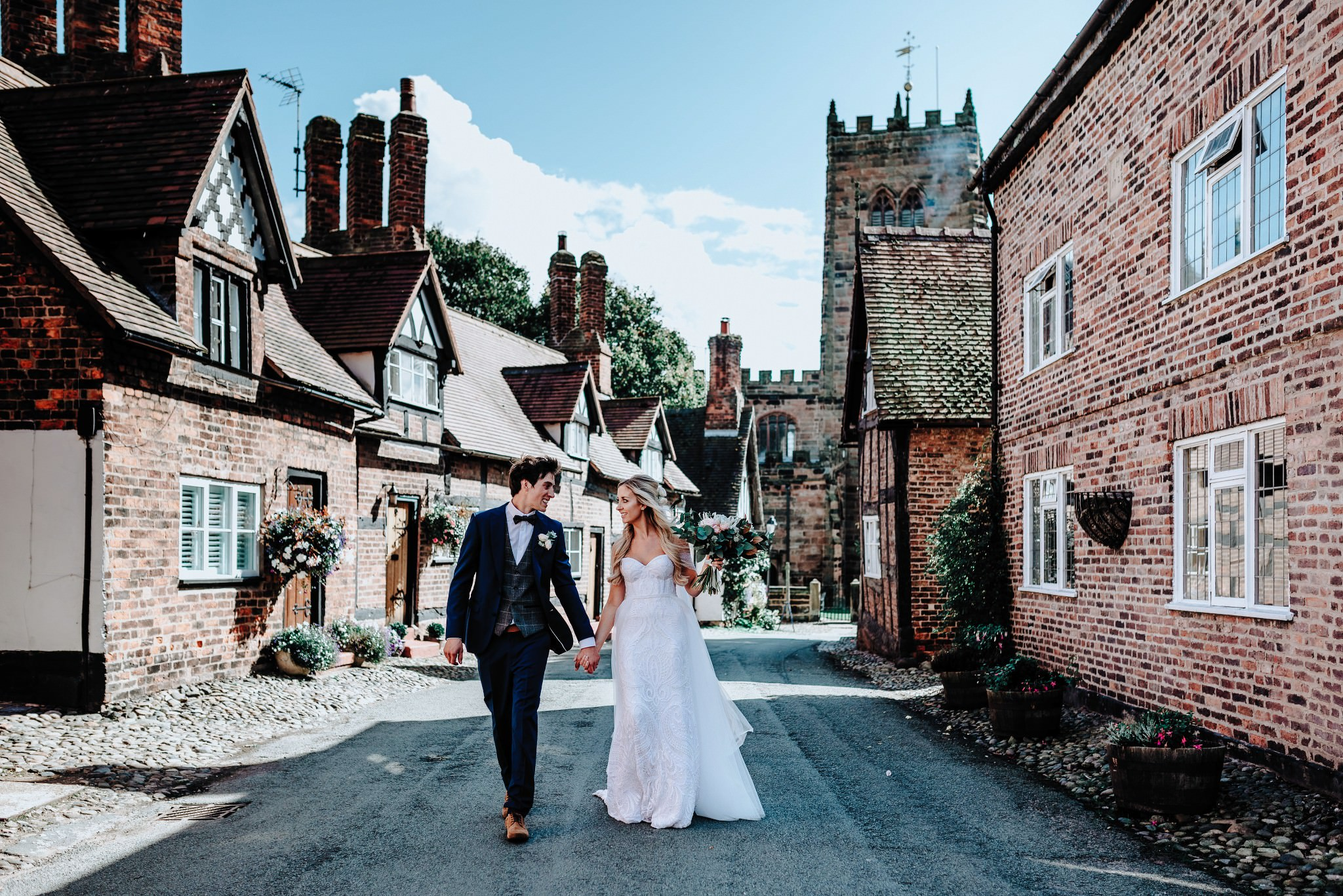 Bride and Groom walking through Great Budworth in Cheshire