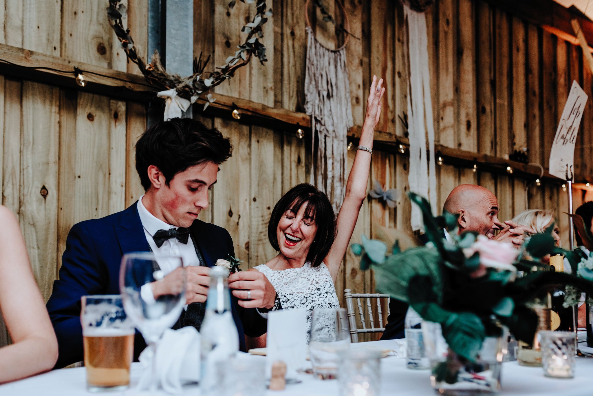 Excited mother of the groom during speeches at Cheshire Barn Wedding