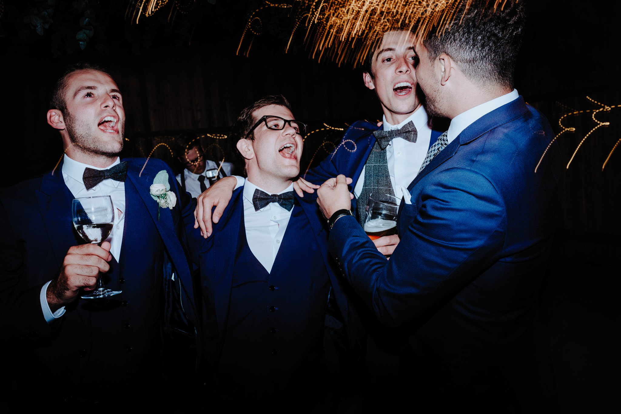Groomsmen dancing and singing at a Cheshire Barn Wedding