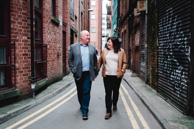 Allison & Carl walking through the streets on their Manchester Engagement Session