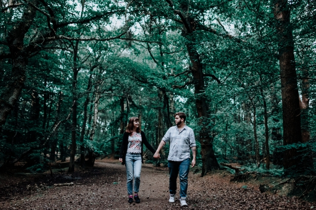 Greg & Holly walking in the woods at their Cheshire Engagement Session