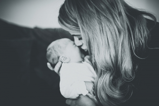 Mum kissing newborn at a Cheshire Lifestyle Family Photography Session