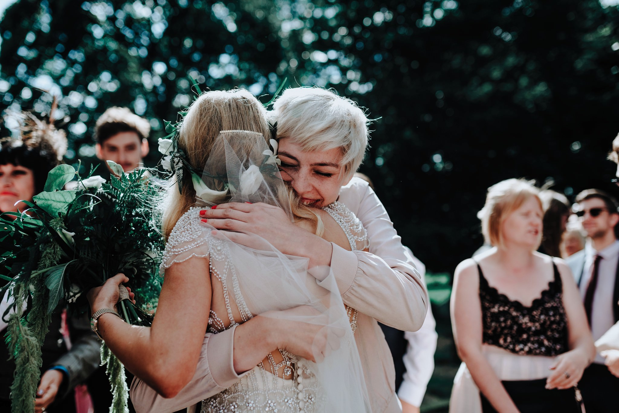 Bride hugging a guest at a Cheshire Barn Wedding