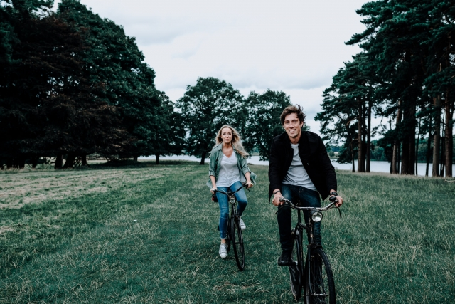 Lauren and Christopher on their vintage bikes at Cheshire Engagement Session