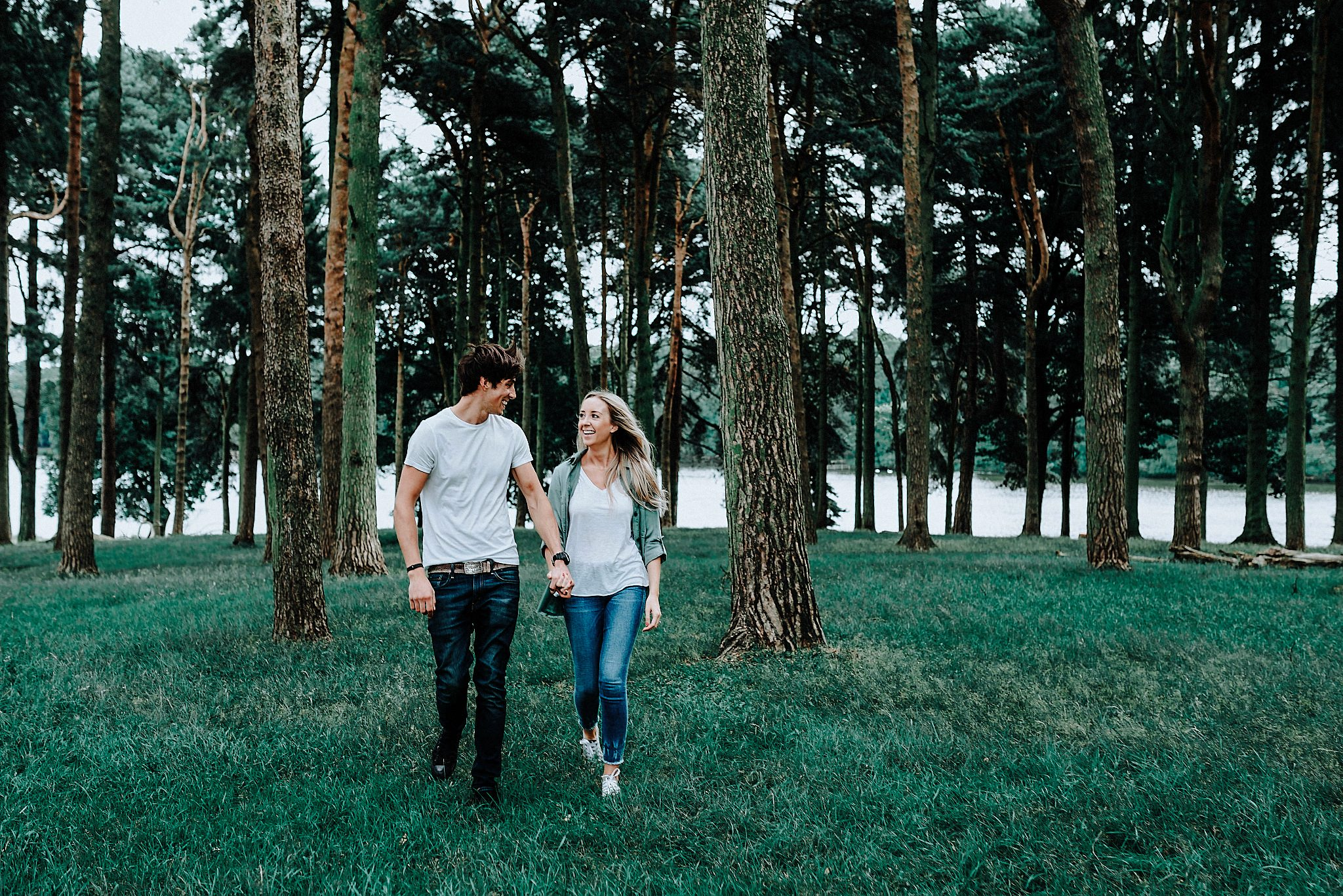 Lauren & Christopher walking hand in hand on their pre-wedding session at Tatton Park, Cheshire