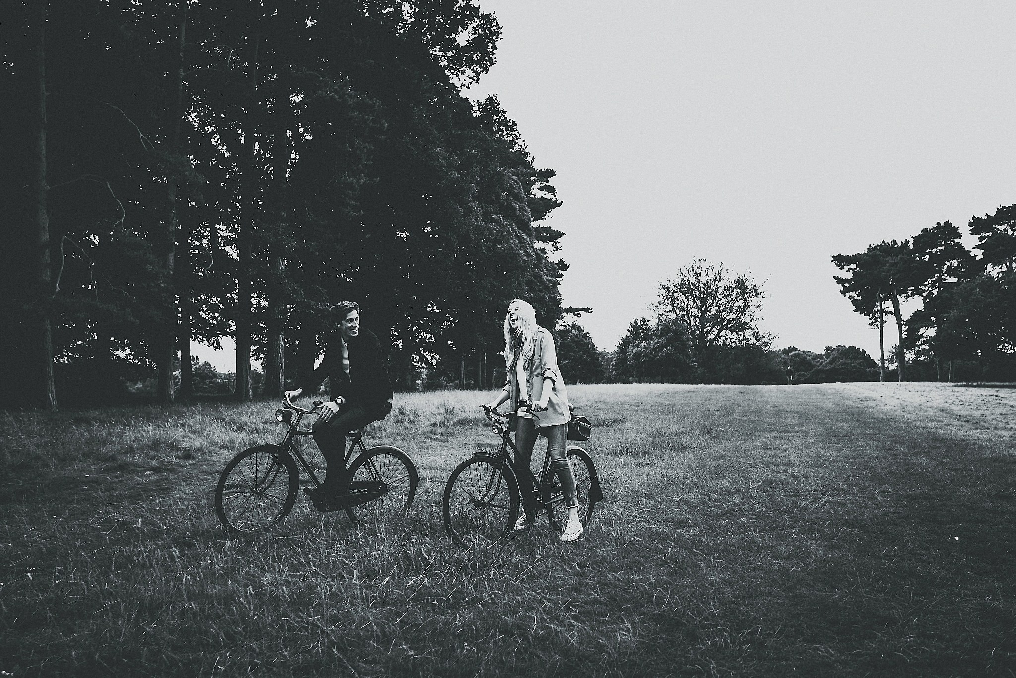 Lauren & Christopher laughing on their vintage bikes in Tatton Park, Cheshire