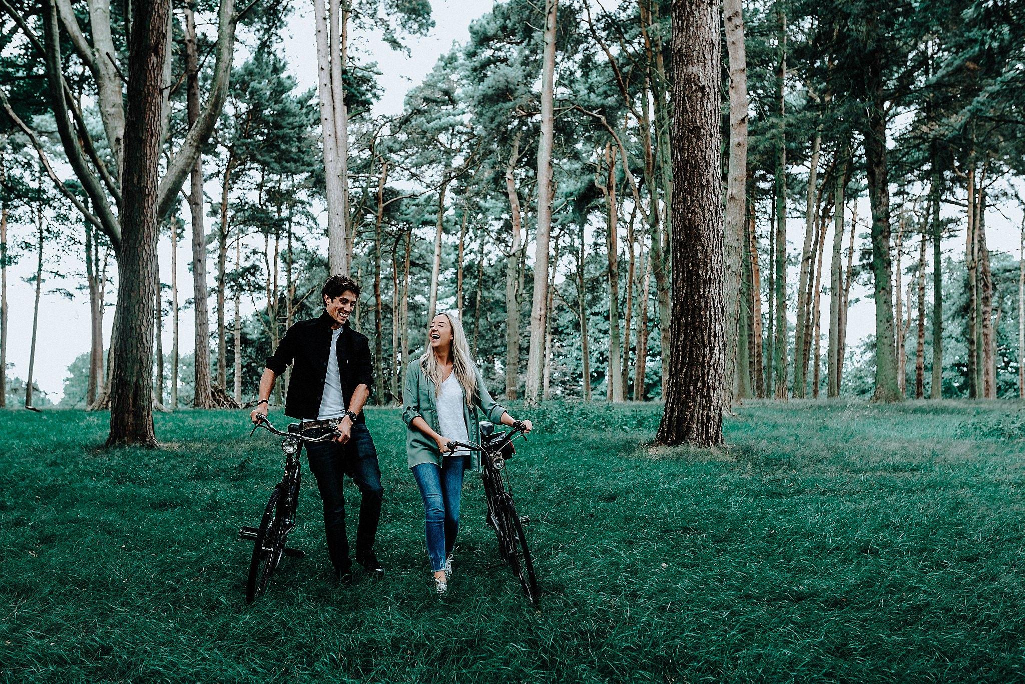Lauren & Christopher walking through Tatton Park with their vintage bikes