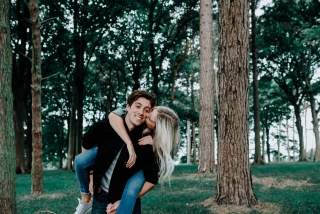 Christopher giving Lauren a piggy back at Cheshire Engagement Session