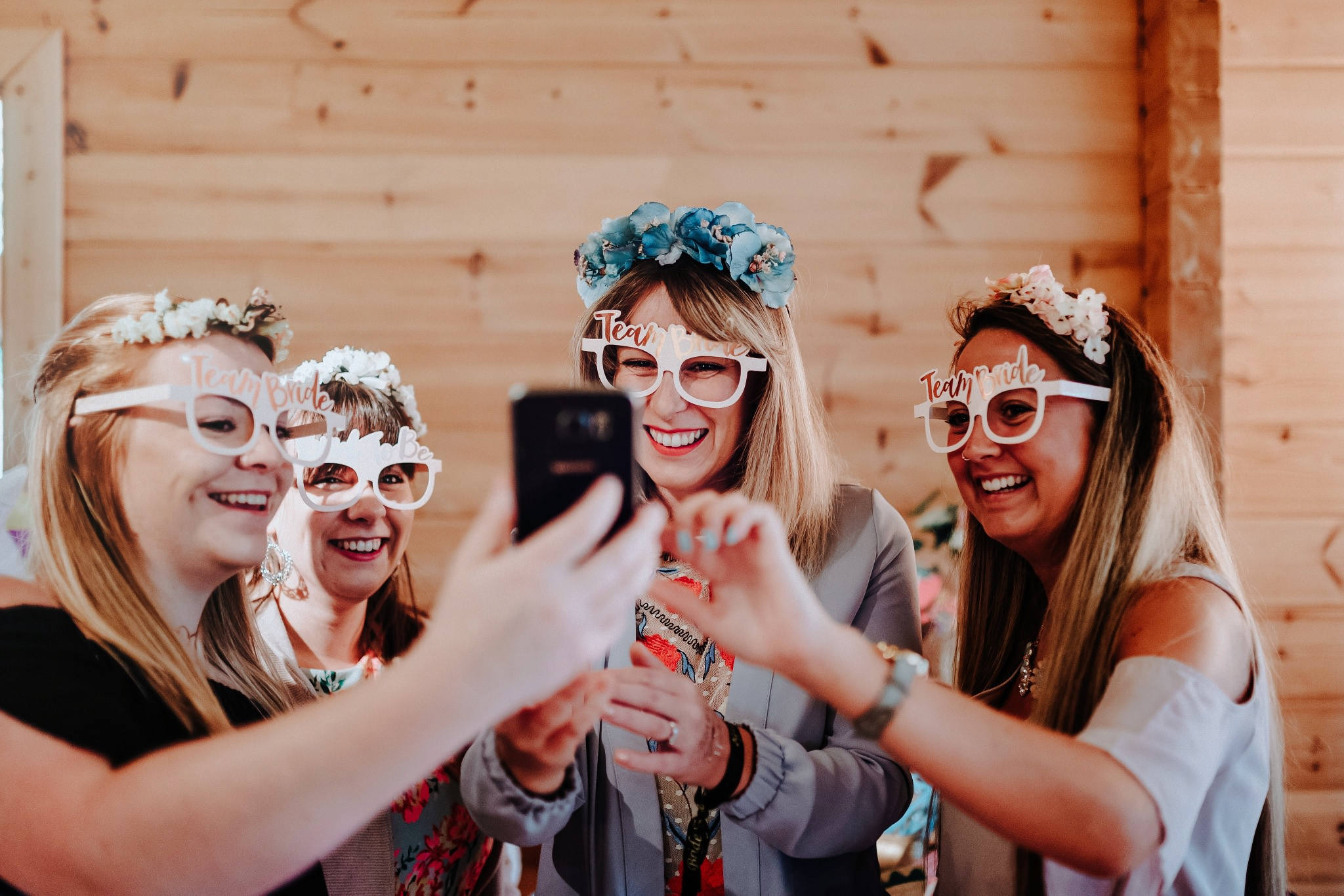 Brides taking selfies at Styal Lodge Bridesmaid Brunch