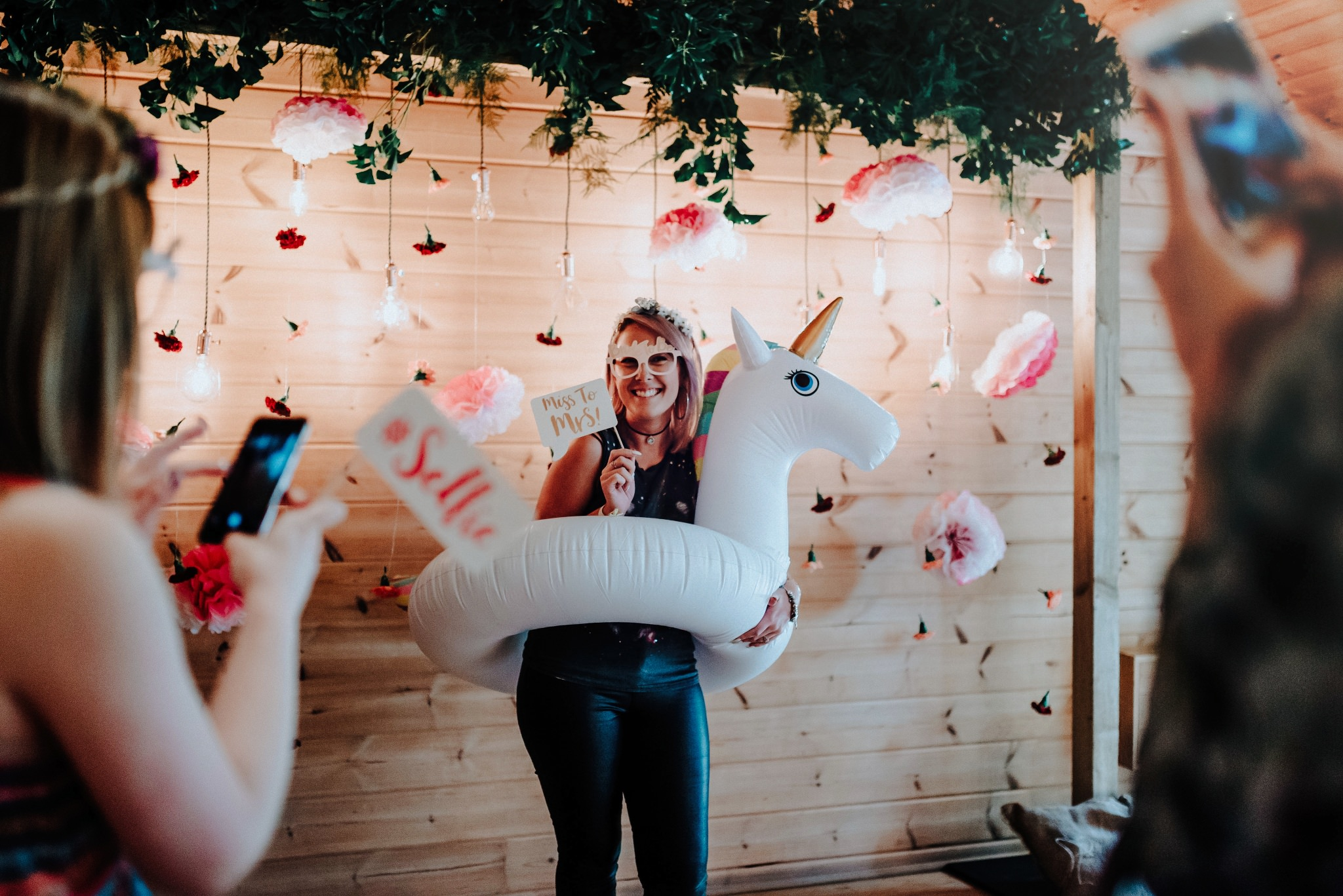 Brides using the unicorn prop at the Styal Lodge photo booth